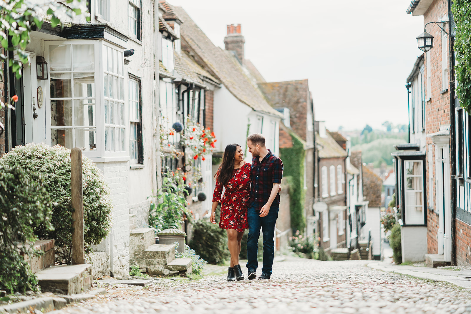couple engagement photography at cobbled mermaid street in Rye